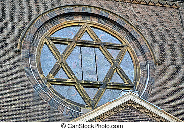 jewish star on vintage church, stone wall details
