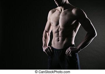 Muscular male torso - Sexy muscular man on dark background