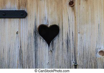 Heart in old wooden door