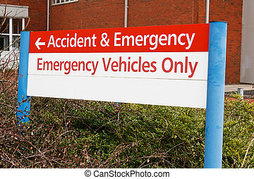 accident and emergency sign at local hospital casualty...