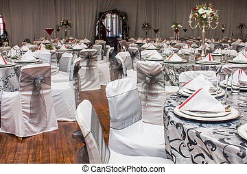 Wedding tables - A decorated wedding table with silver and...