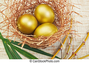 Gold eggs in the nest. Concept for Easter.