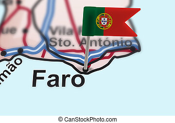 pin with flag of Portugal in Faro with selective focus