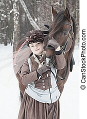 woman keeps the Arab racer in the brown riding habit