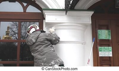 Woman while whiten a column - Ukranian woman while whiten a...