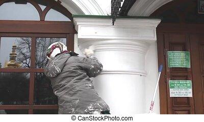 Woman while whiten a column - Ukranian woman while whiten a...