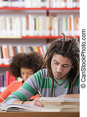 Two students in a library