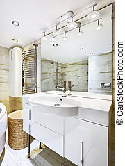 Wash stand with mirror in modern white bathroom interior -...