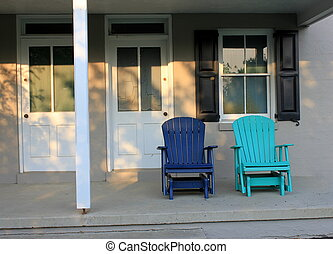 Two blue chairs on a porch