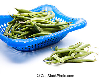 Green bean in the plastic basket