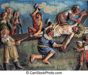 Crucifixion: Jesus is nailed to the cross