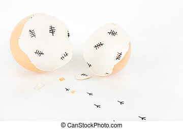 Broken egg shell with tally marks inside and chick...