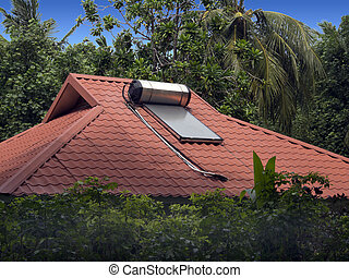 Solar water heater sits on the roof of a home in the Maldive...