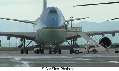 Air Force One with mountains in the background