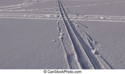 ski sport footprints on fresh snow - ski sport footprints on...