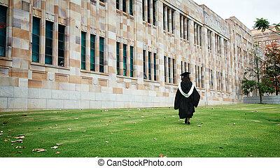 Graduation - Back portrait of a woman graduating against...