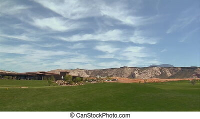 golf course with beautiful clouds