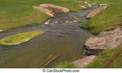 tilt up as stream flows through golf course