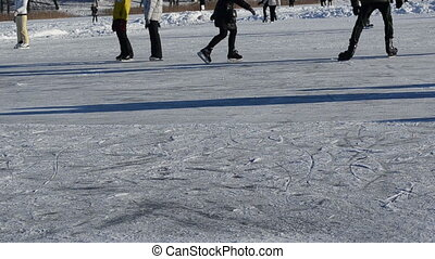 people slide lake winter