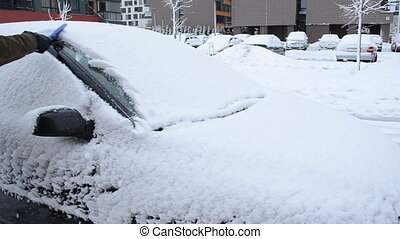 man remove snow car brush - man hand removing snow from car...