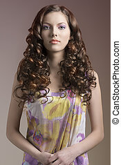 pretty brunette with curly hair in front of the camera -...