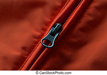 Red and Orange Coat Zipper - Closeup of zipper on orange or...