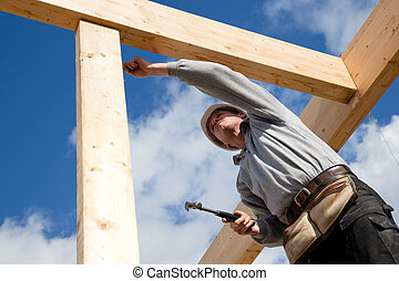 authentic construction worker - carpenter at work with...