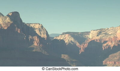 Zoom out of distant vista in Zions National Park