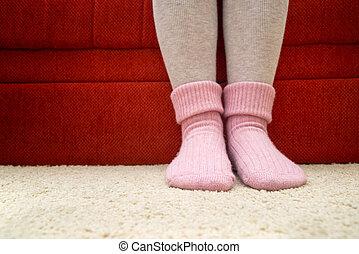 Warm woolen socks - Female legs wearing beautiful warm pink...
