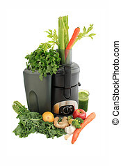 Juicing fresh vegetables and fruit - Juicer surrounded by...