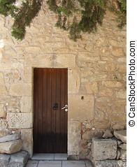 Wooden Door - Wooden door in stone building, exterior