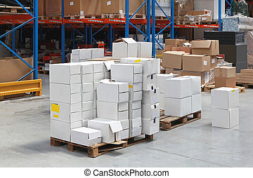 Distribution Warehouse - Pile of boxes at pallets in...