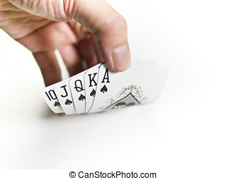 pokers of playinf cards - A royal straight flush playing...