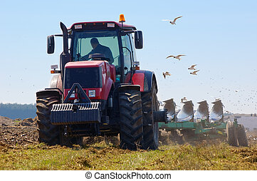 Farmer plowing the new field - Tractor plowing the new field...