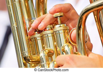 Tuba theme - Men playing on a golden tuba or euphonium