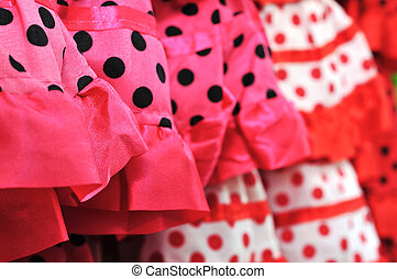 flamenco dresses - closeup of a pile of flamenco dresses,...
