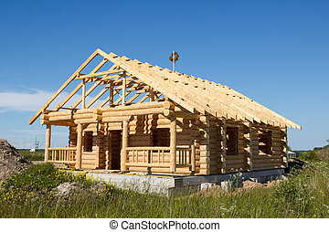 house built from logs - new wooden house built from logs