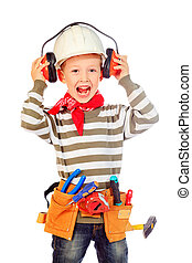occupational safety - Little boy in a helmet plays in the...