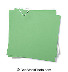 green and white sticky notes with paper clip in shape of...