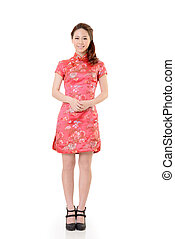 Smiling Chinese woman dress traditional cheongsam at New...