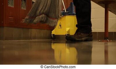 Shot of mop head being pushed around floor