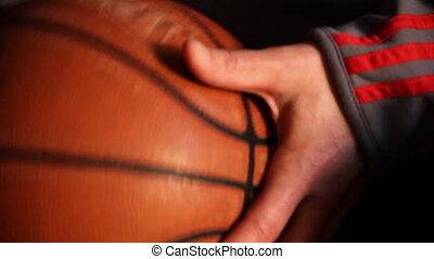 Close-up shot of worn basketball in hands