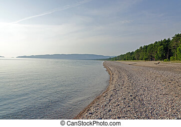 Shore of Superior Lake - Green and blue water of Superior...