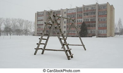 playground snow fall - old wooden child playground in...