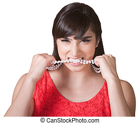 Frustrated Woman Chewing on Necklace - Frustrated woman with...