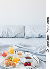 Healthy breakfast in bed - Tray with healthy breakfast on a...
