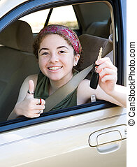 Teen With Keys Thumbsup - Cute teen driver holding the car...