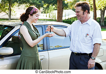Handing Over Keys - Father or driving instructor handing...