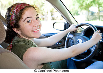 Pretty Teen Driver - Beautiful, confident teen girl behind...