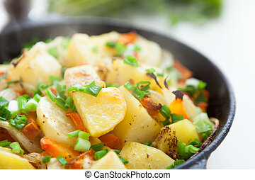 golden pieces of fried potatoes, closeup